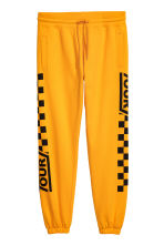 Sweatpants with a print motif - Bright yellow - Men | H&M CN 1