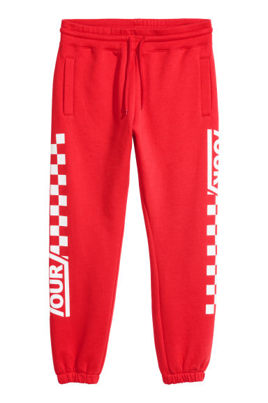 Sweatpants with a print motif - Bright red - Men | H&M CN 1