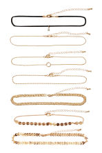 7-pack chokers - Gold-coloured - Ladies | H&M IE 1