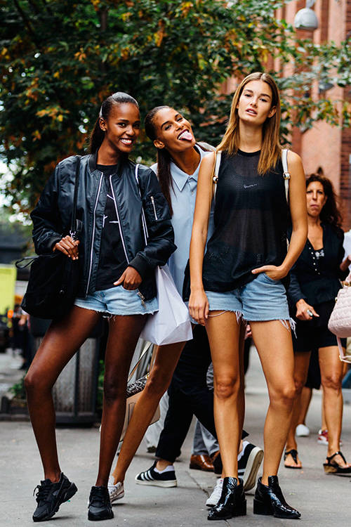 Ophelie Guillermand with model friends Leila Nda and Cindy Bruna at New York Fashion Week S/S 2016, Getty Images.