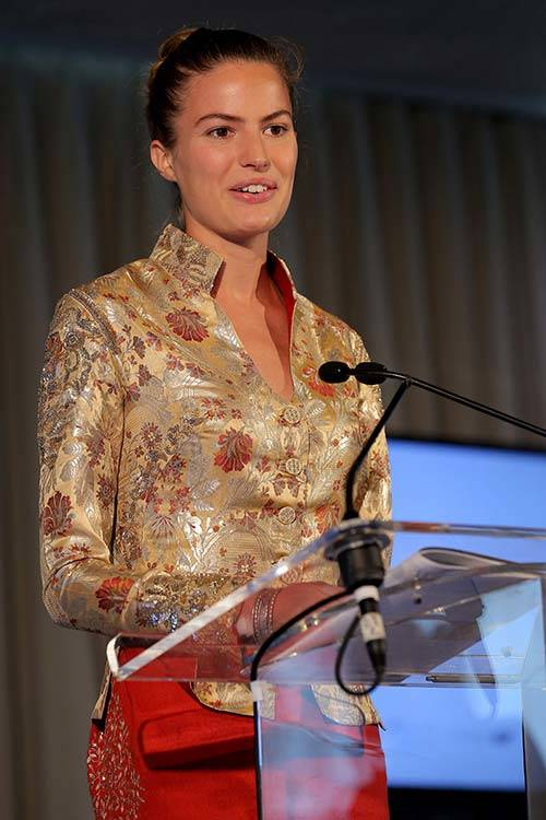 Cameron Russell speaks onstage during Women Empowering Women Luncheon at the UN in 2014, Getty Images.