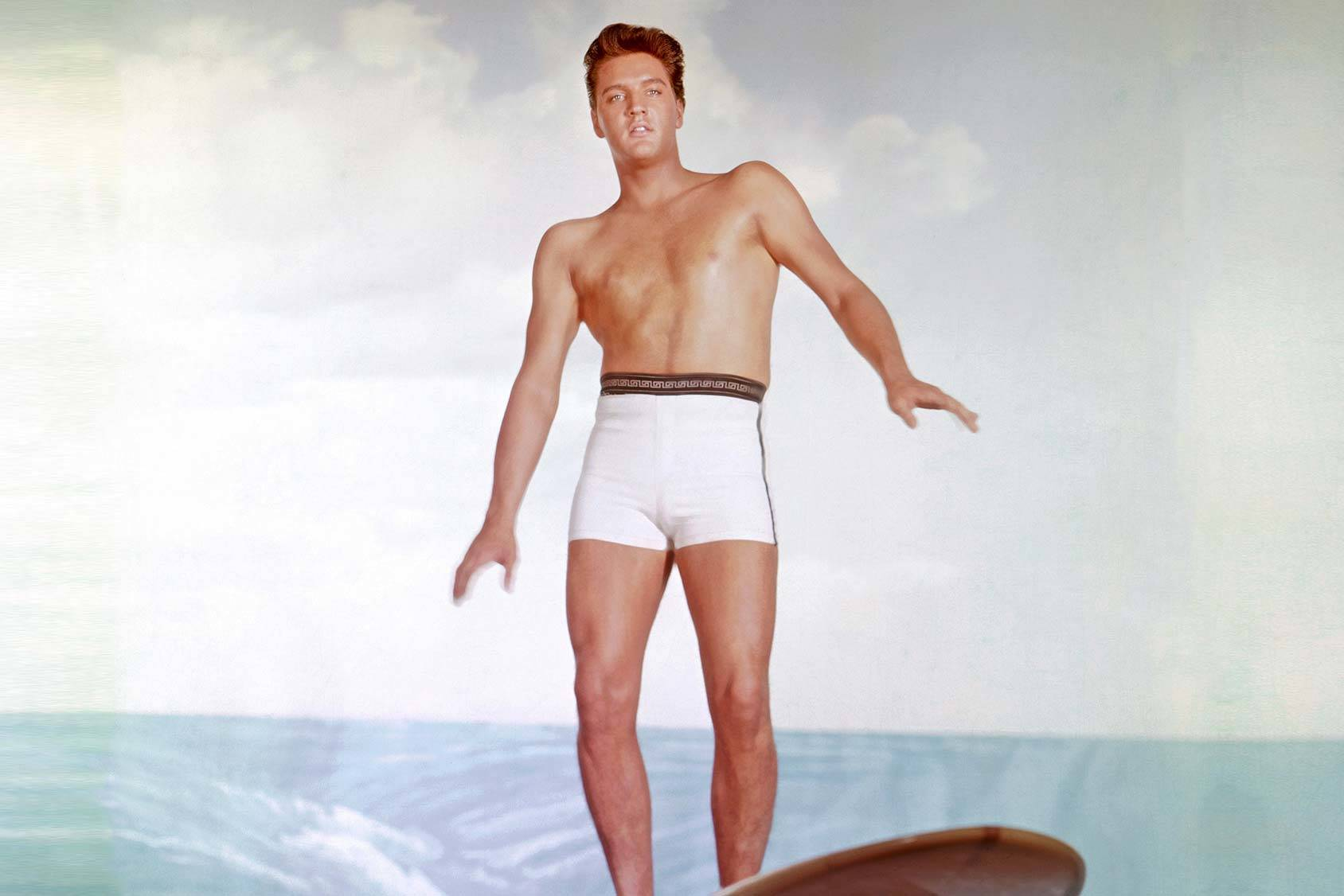 Elvis Presley showing off his surf skills in the movie Blue Hawaii, Getty Images.