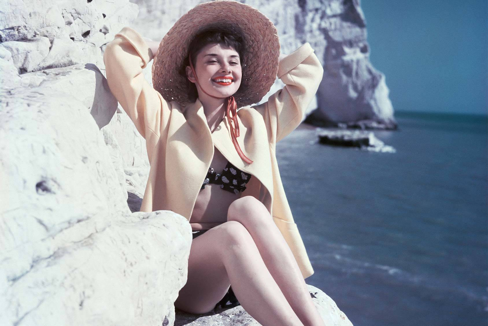 Style icon Audrey Hepburn enjoying a day at the beach, Getty Images.