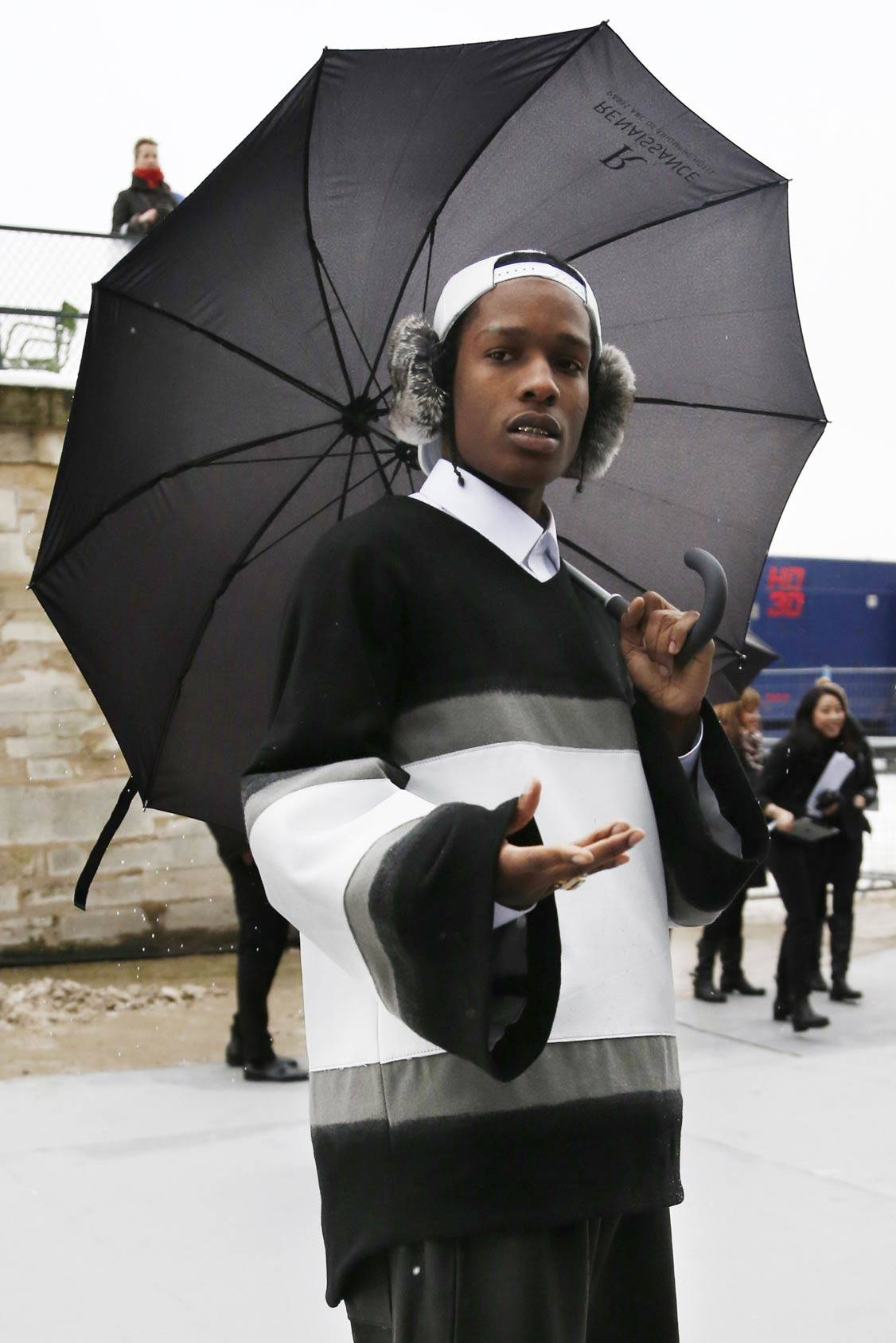 Rapper A$ap Rocky arrives in style to the Christian Dior Haute Couture Spring-Summer 2013 collection, All Over Press.
