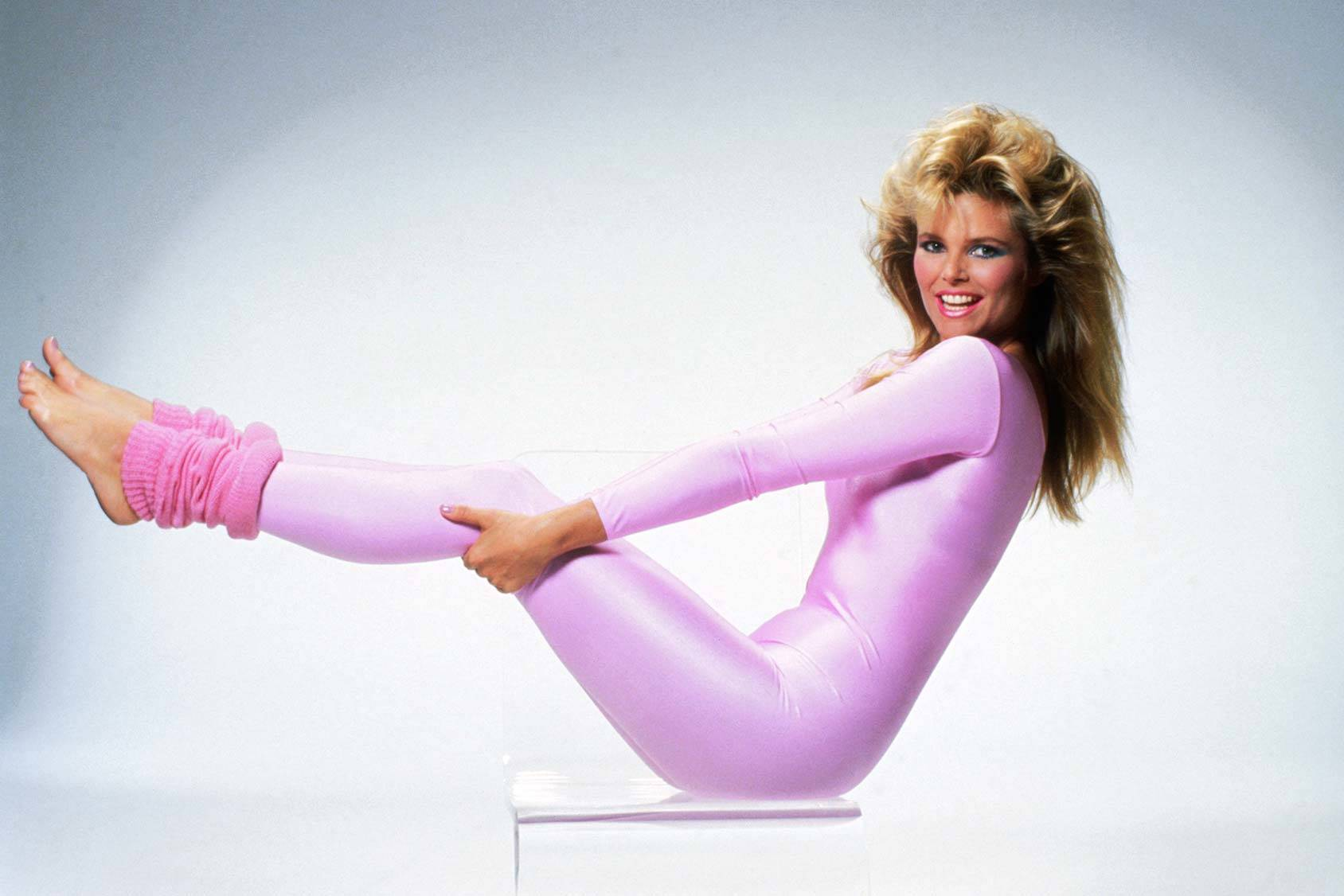 Christie Brinkley works out in pink leg warmers, All Over Press.