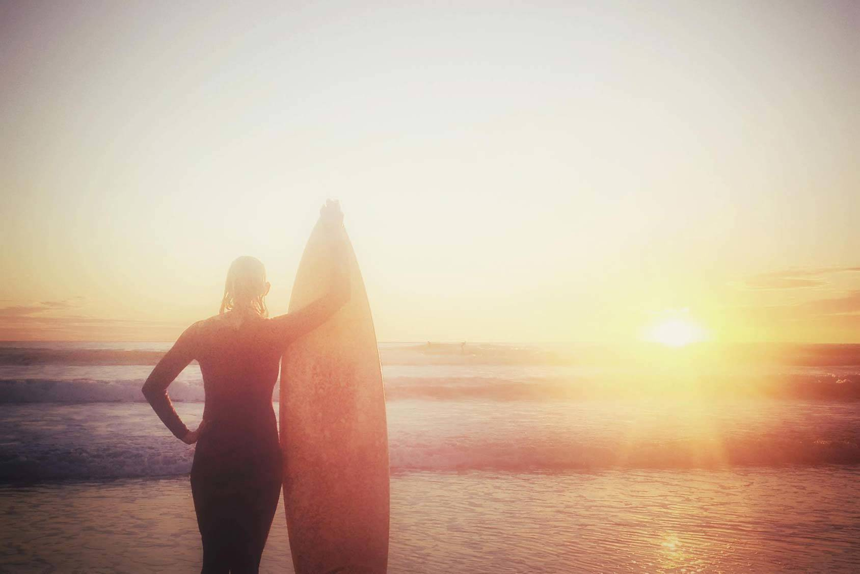 Garance Doré shares her love for surfing and her 3 tips for getting better at it, Getty Images.