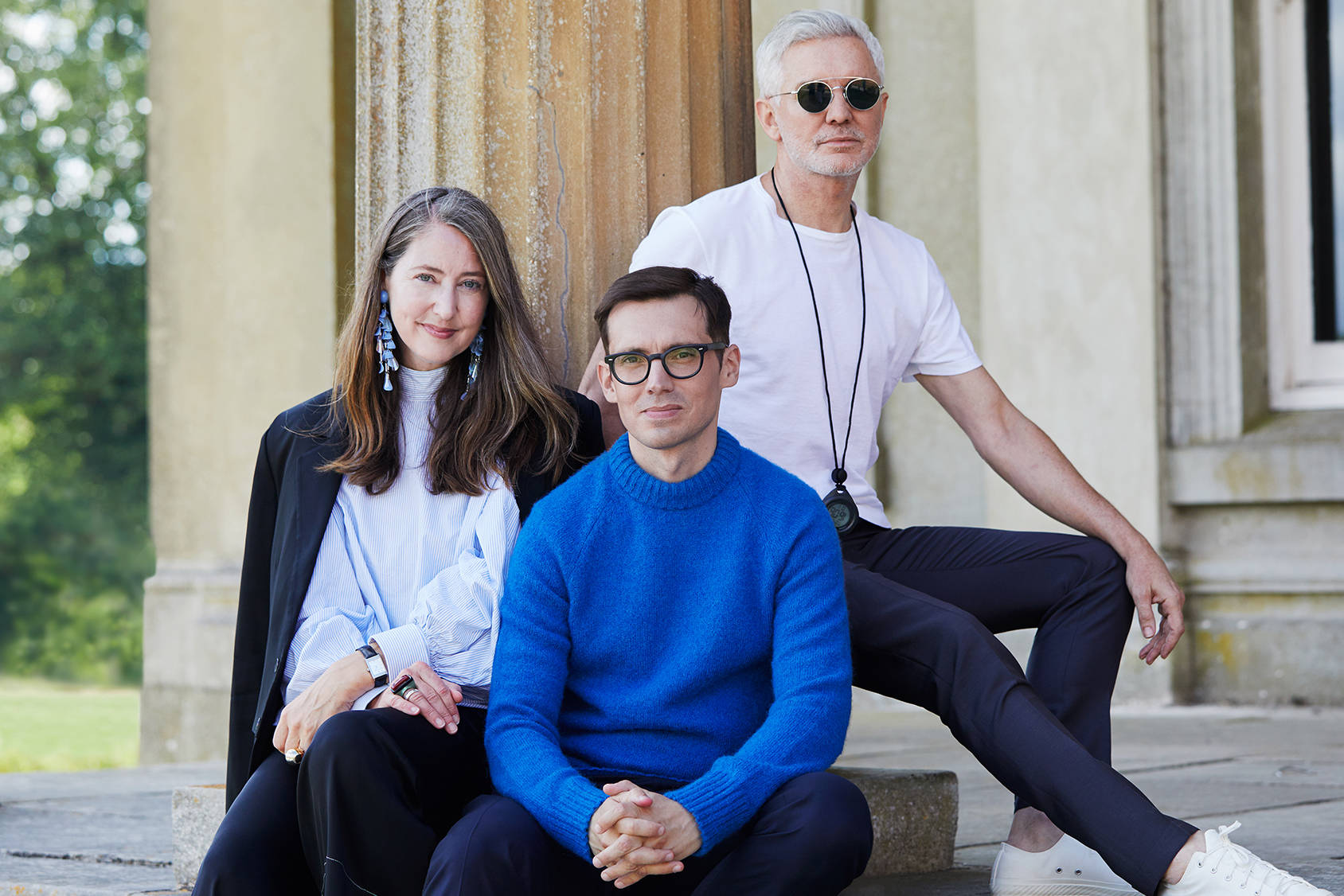 H&M creative advisor Ann-Sofie Johansson, designer Erdem Moralıoğlu, and filmmaker Baz Luhrmann together on set in England.