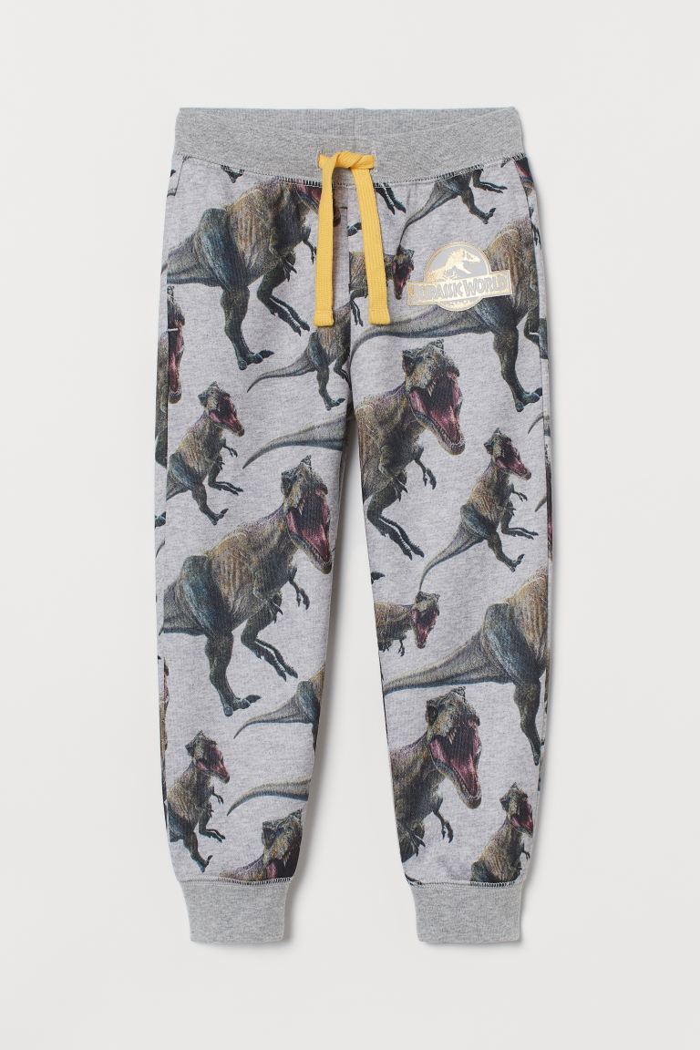Printed sweatpants - Light grey marl/Jurassic World - Kids | H&M