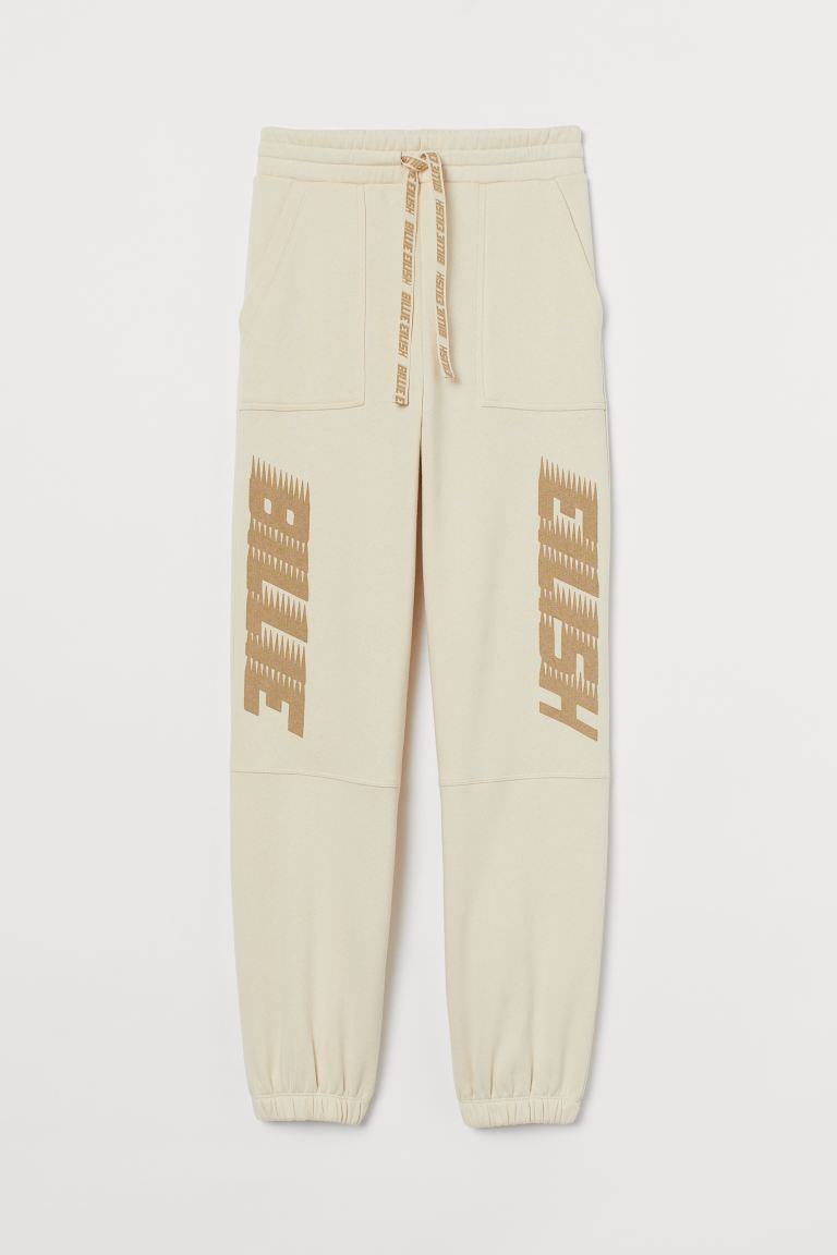 Oversized joggers - Lichtbeige/Billie Eilish - DAMES | H&M BE