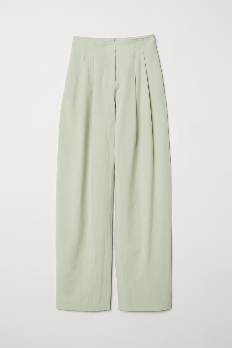Wide lyocell-blend trousers - Light green - Ladies | H&M GB