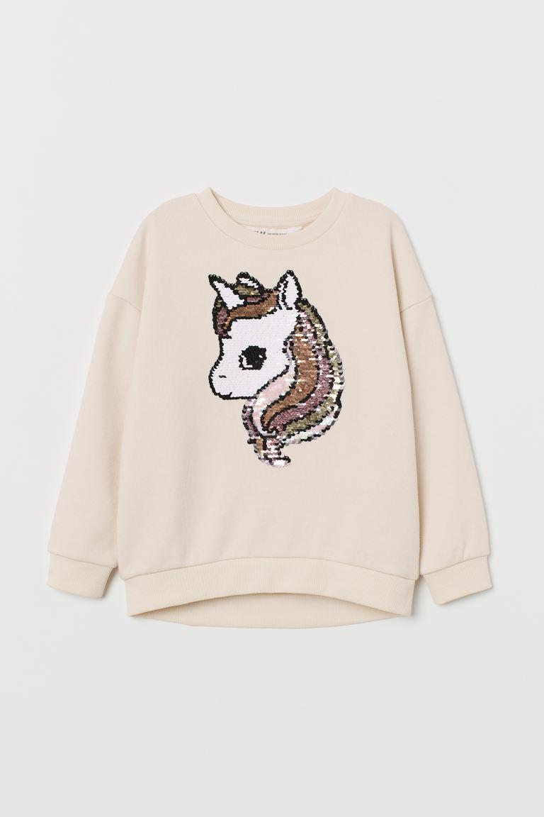 Sweatshirt with a motif