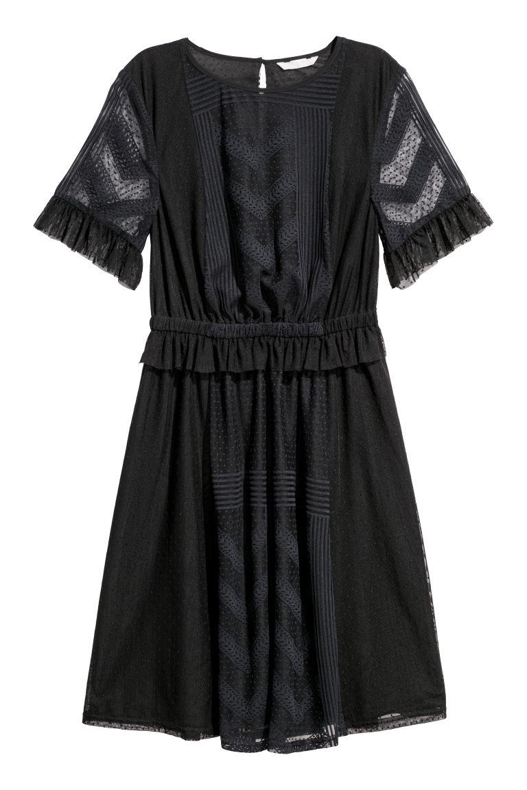 svart knälång klänning