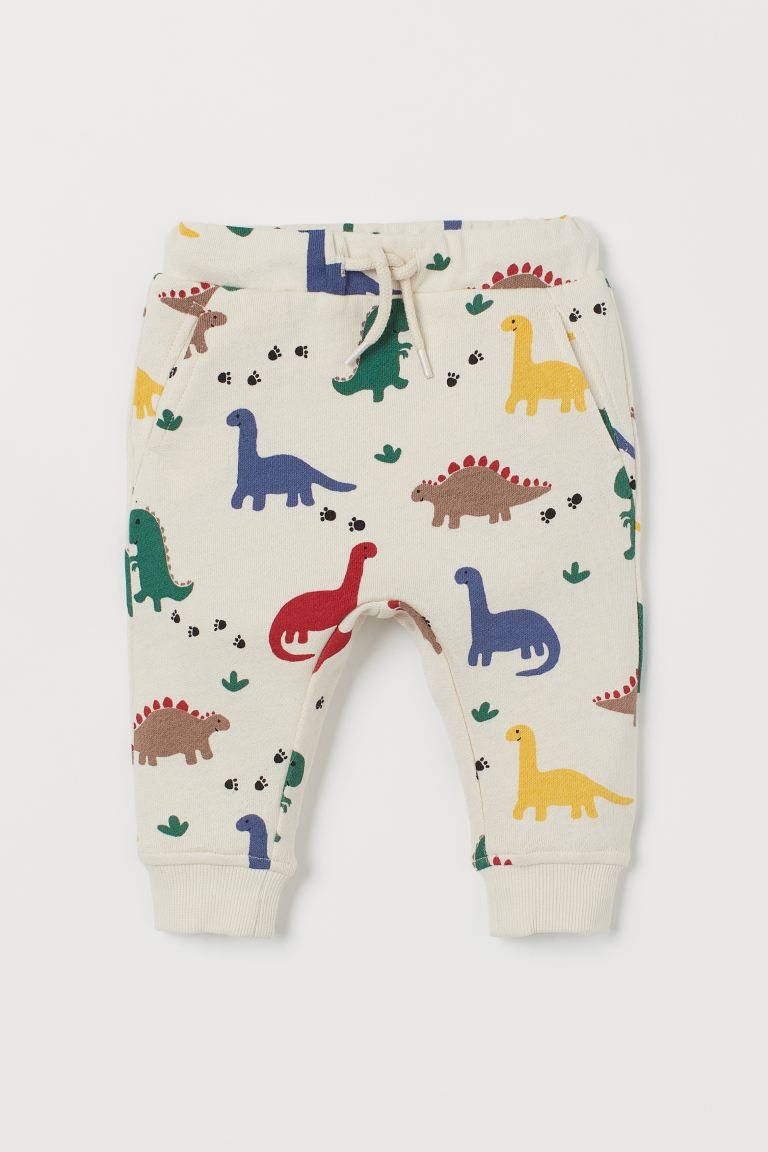 Cotton joggers - Light beige/Dinosaurs - Kids | H&M IN