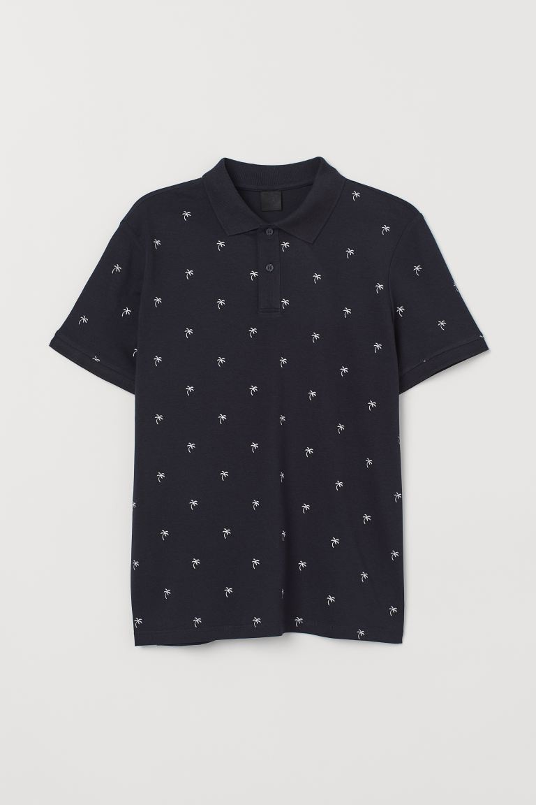 Polo shirt Slim Fit - Dark blue/Palm trees - Men | H&M