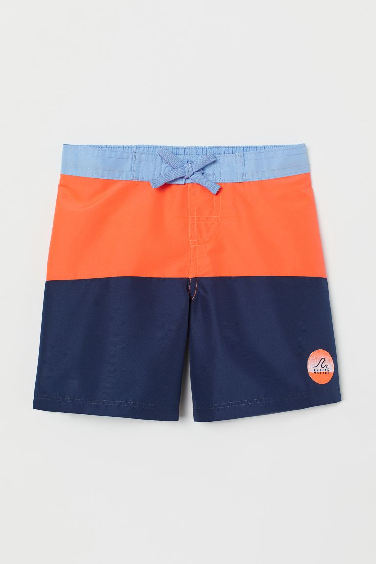 Swim shorts - Dark blue/Neon orange - Kids | H&M