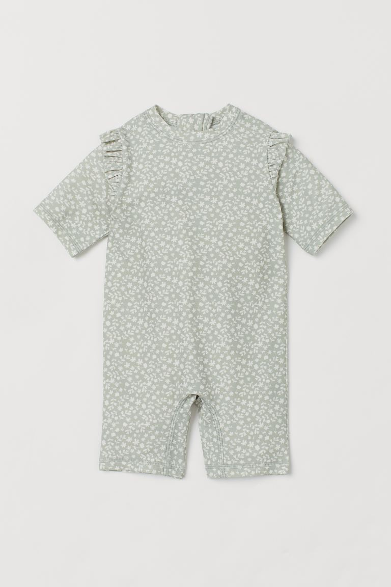 Swimsuit with UPF 50 - Light green/White floral - Kids | H&M