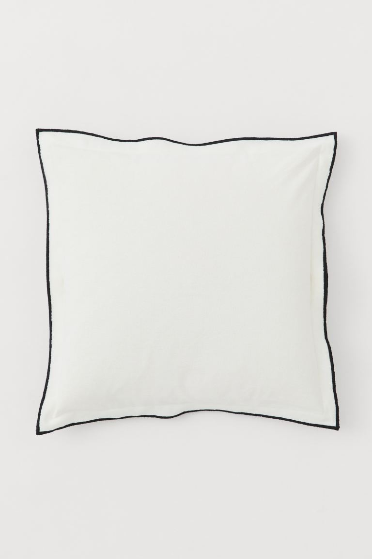 Copricuscino misto lino - Bianco naturale/nero - HOME | H&M IT