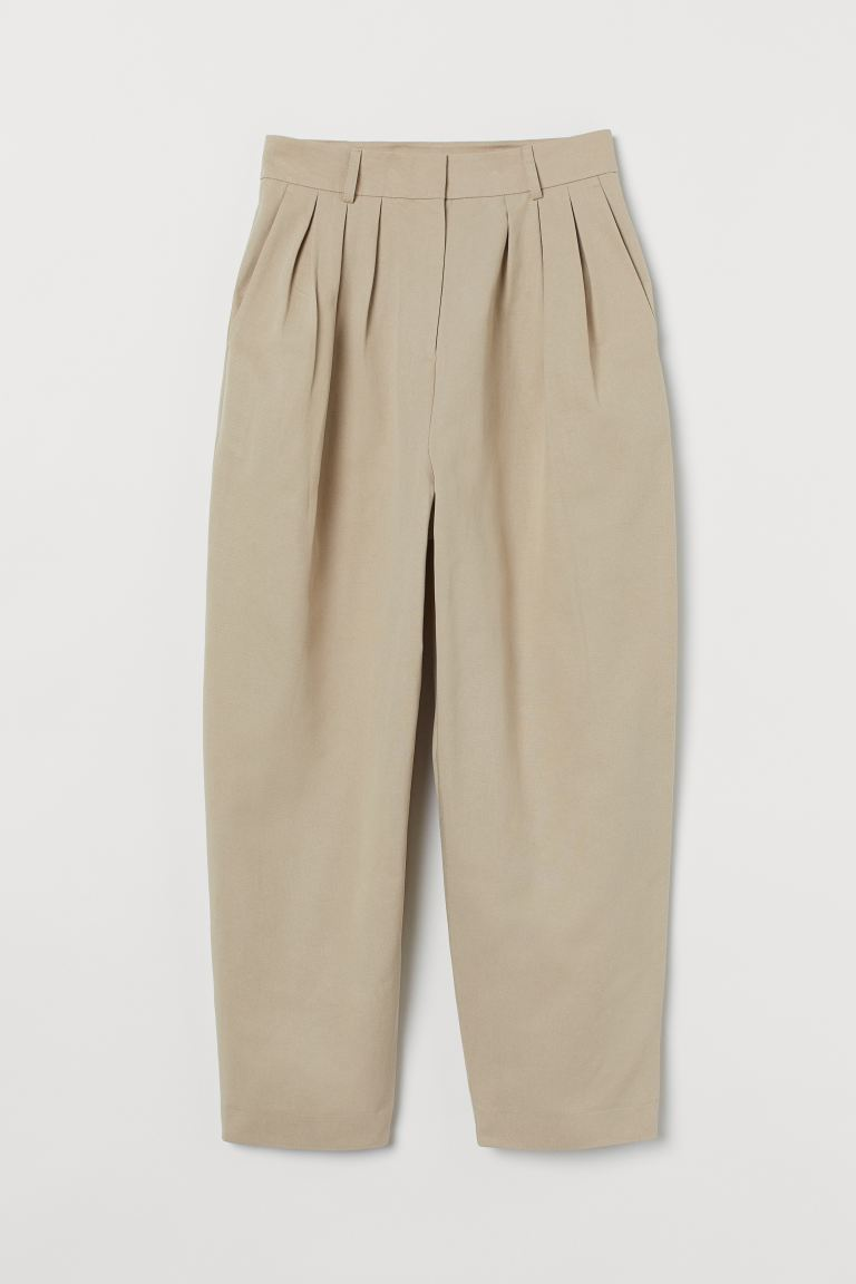 Wide lyocell-blend trousers - Light khaki beige - Ladies | H&M IN