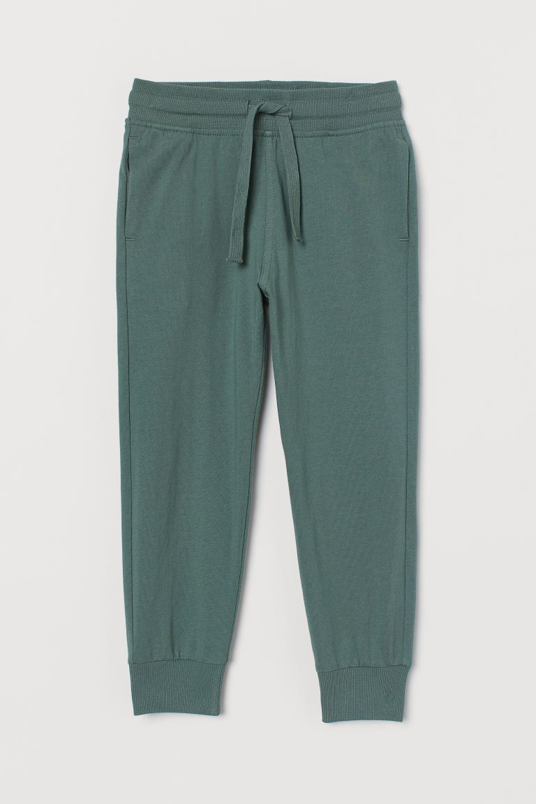 Cotton jersey joggers - Green - Kids | H&M