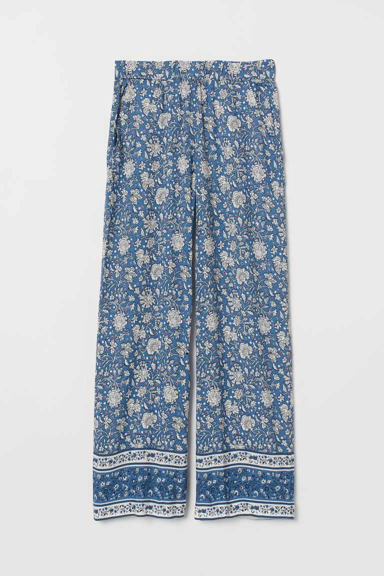 Wide pull-on trousers - Blue/Floral - Ladies | H&M