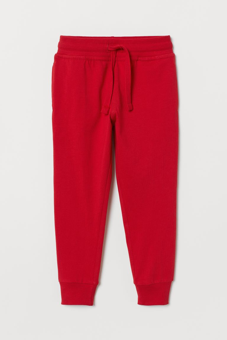 Cotton jersey joggers - Red - Kids | H&M
