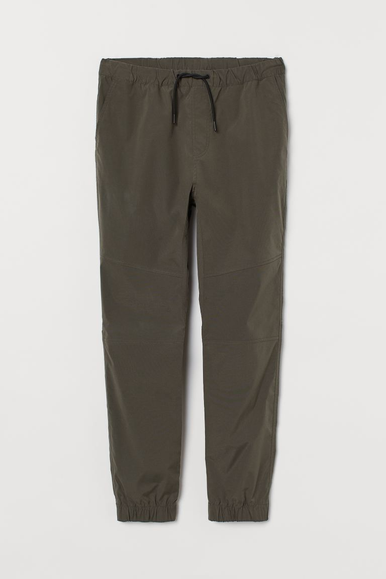 Joggers with a sheen - Khaki green - Men | H&M