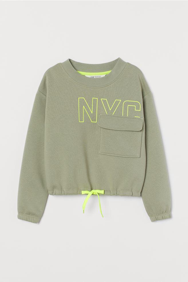 Sweatshirt with Text Design - Light khaki green/neon yellow - Kids | H&M US 2