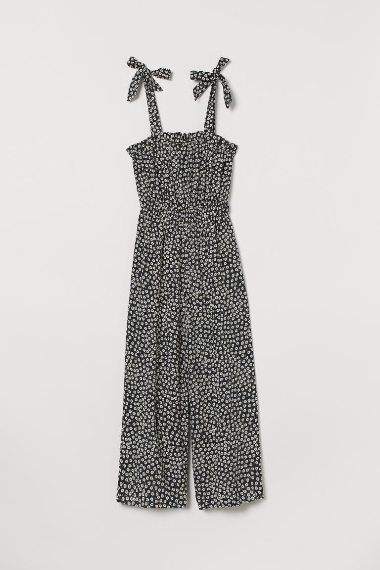 Flounce-trimmed jumpsuit - Black/White floral - Ladies | H&M IE