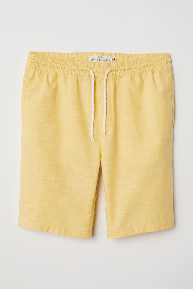 Knee-length cotton shorts - Yellow - Men | H&M GB