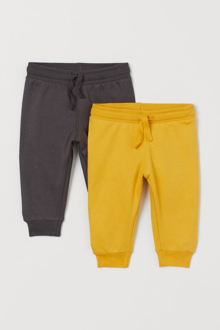 2-pack cotton joggers - Yellow/Dark grey - Kids | H&M IN