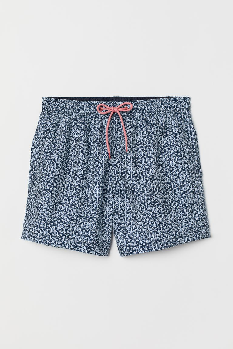 Printed swim shorts - Dark blue/White patterned - Men | H&M