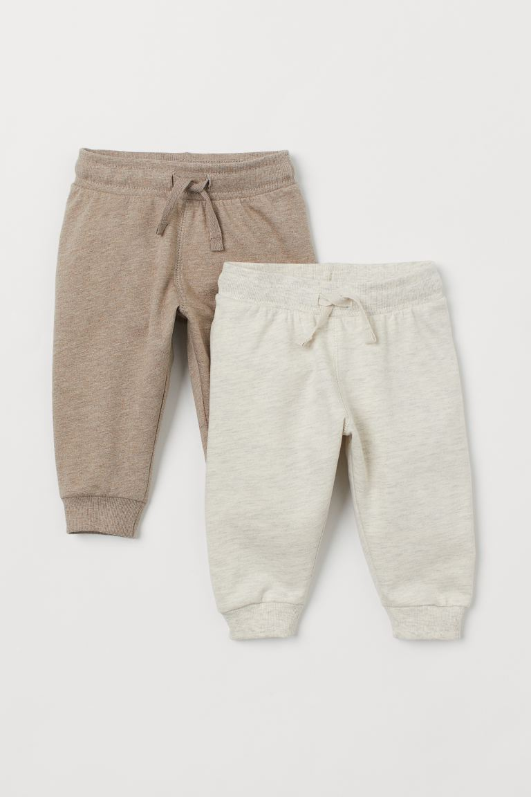 2-pack cotton joggers - Light beige/Beige marl - Kids | H&M IN
