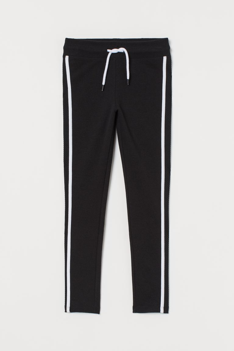 Joggers with side stripes - Black/White - Kids | H&M IE