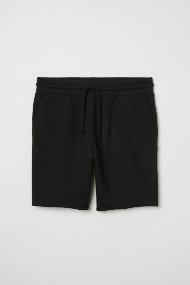 Raw-edged sweatshirt shorts - Black - Men | H&M