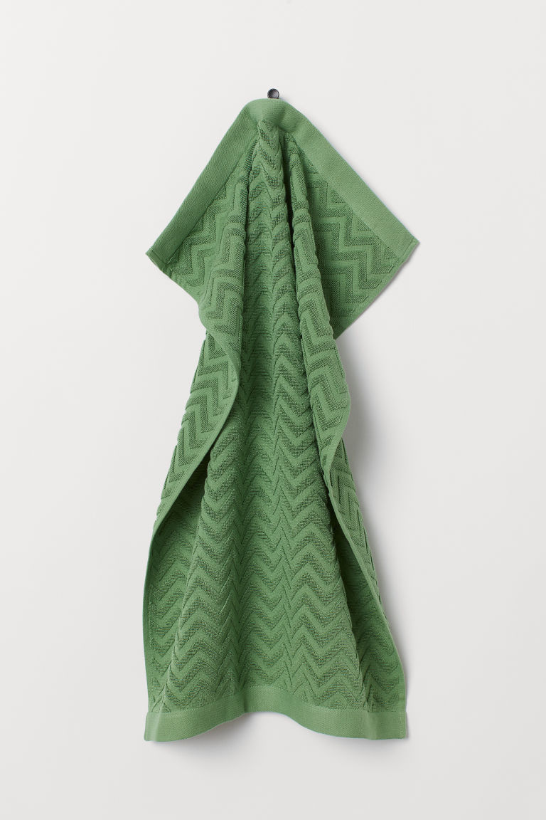 Jacquard-patterned hand towel - Dark green - Home All | H&M CN