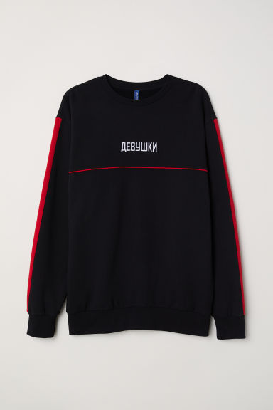 Sweatshirt with an appliqué - Black - Men | H&M IE
