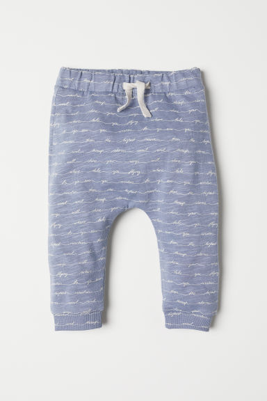 Joggers with a text print - Dusky blue - Kids | H&M