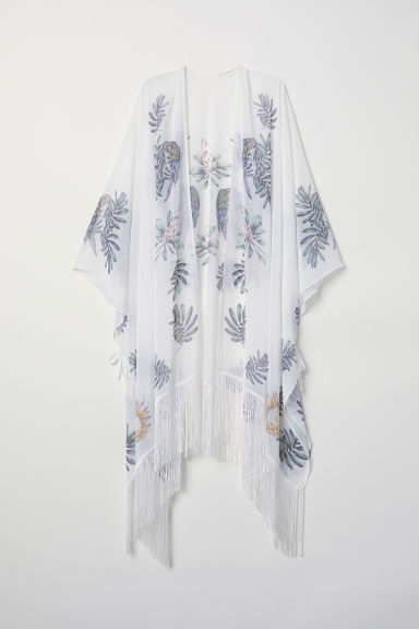 Poncho con frange - Bianco/fantasia - DONNA | H&M IT