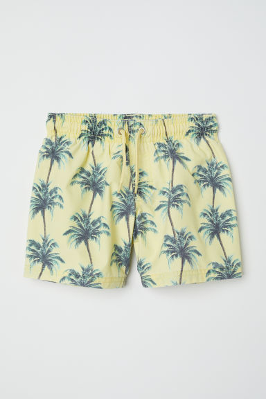 Patterned swim shorts - Light yellow/Palm trees - Kids | H&M