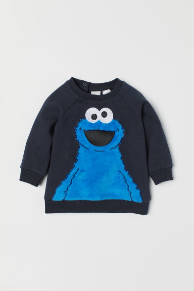 Sweatshirt with a motif - Dark blue/Sesame Street - Kids | H&M