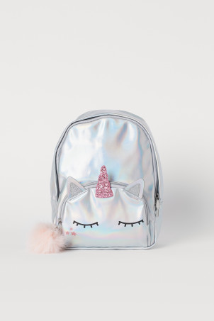 Backpack with a pompom