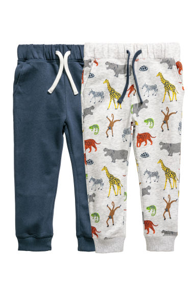 2-pack joggers - Light grey/Wild animals - Kids | H&M CN