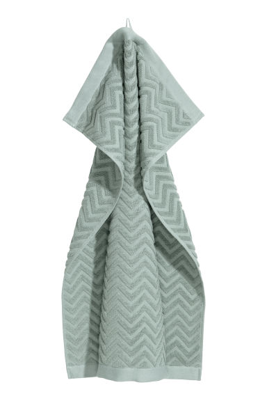 Jacquard-patterned hand towel - Light green - Home All | H&M IE