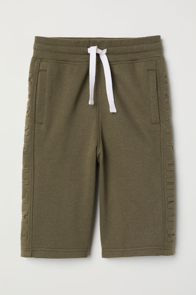 Sweatshirt shorts - Dark khaki green/California - Kids | H&M CN