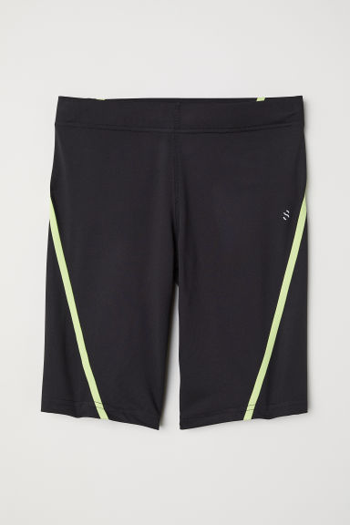 Short running tights - Black/Neon yellow - Men | H&M