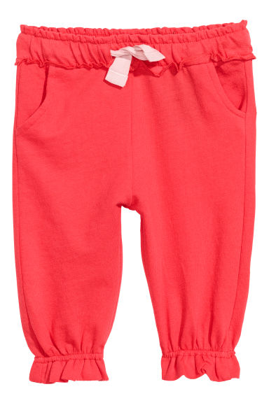 Joggers met volants - Koraalrood -  | H&M BE