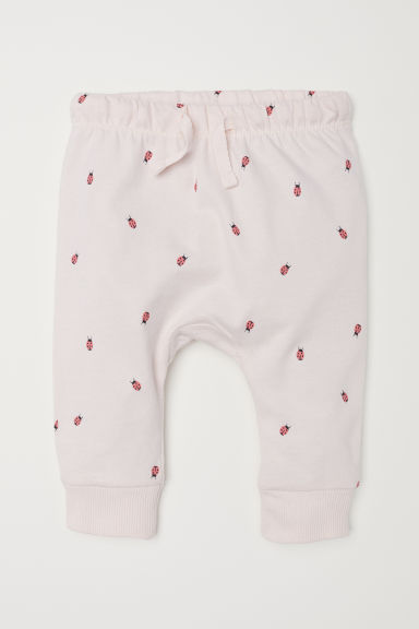 Jersey trousers - Powder pink/Ladybirds - Kids | H&M