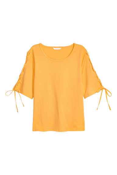 Cotton top with lacing - Yellow - Ladies | H&M