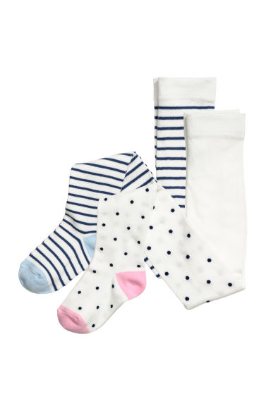 2-pack tights - White/Dark blue spotted - Kids | H&M