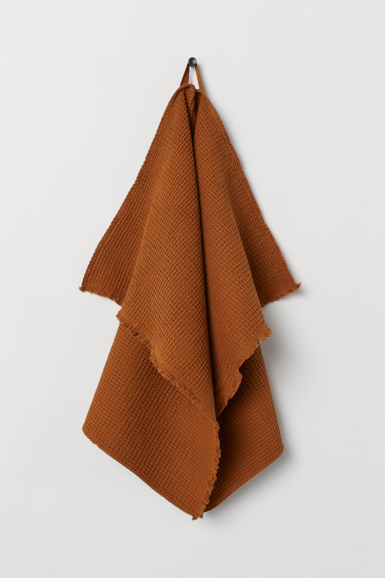 Waffled hand towel - Ochre - Home All | H&M GB